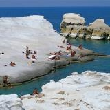 Sarakiniko beach, swimmers & people sunbathing on rocks