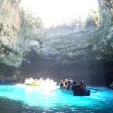 Melissani Cave lake: The sunrays shed light all over the open-roofed cave